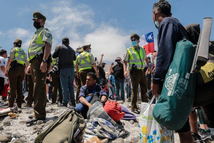 Una marcha contra migrantes en Iquique, Chile, terminó en violencia